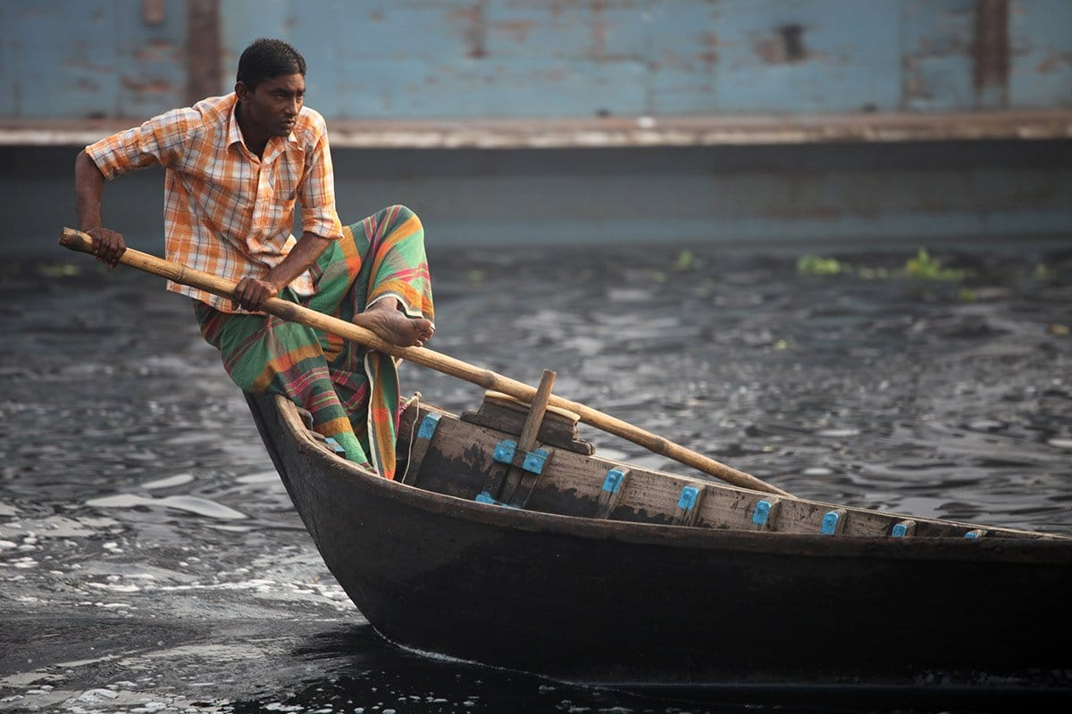 Man balanced on boat Bangladesh