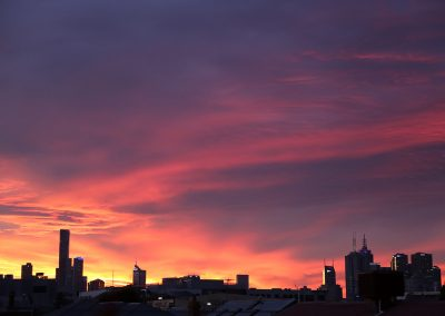 Mike Hill Moonshine Agency Melbourne skyline at sunset